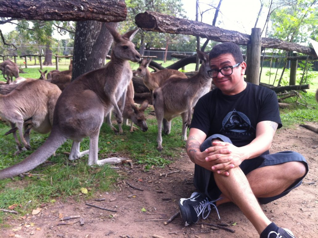 """Brian gets to travel the world thanks to music!"" is what we would have captioned this if we were bored. But we're not, so we're captioning it ""Why would Brian send us a picture of him surrounded by kangaroos?"""