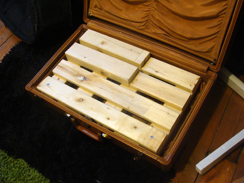 Click this picture because this guy actually did build a wood pedalboard in a suitcase for $6